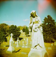 (s myers) Tags: film cemetery grave graveyard mediumformat square holga lomo xpro lomography kentucky ky crossprocess headstone stlouis slide lightleak 200 louisville vignette 120mm 120n photoworkssf