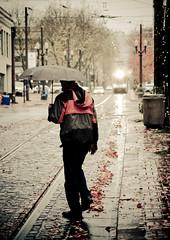 Umbrella Man Crossing the Max Line (Orbmiser) Tags: storm rain oregon umbrella walking portland nikon pedestrian d90 stocksale 55200vr