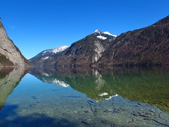 At the Knigssee lake (echumachenco) Tags: lake snow water reflections bayern bavaria berchtesgaden march nationalpark soe jenner musictomyeyes autofocus knigssee kehlstein flickraward platinumheartaward flickrestrellas flickraward5 mygearandme dblringexcellence tplringexcellence eltringexcellence