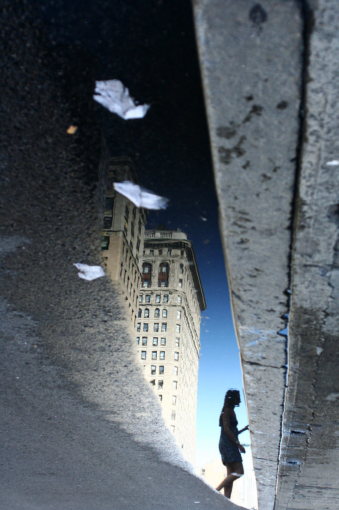 Reflection on a pool, Fifth Ave, NYC