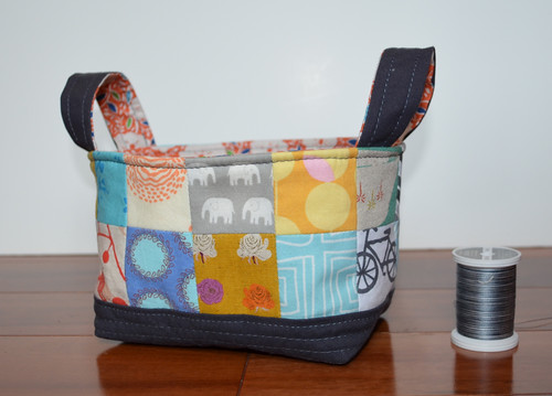 "Fabric Basket with 2"" spool of thread for scale - small but so cute."