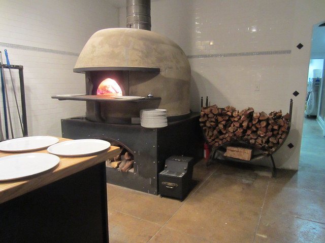Wood burning pizza oven at Mother Dough. Umamimart.com