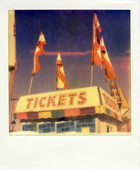 Tickets (Nick Leonard) Tags: carnival blue autumn red sky signs fall film festival analog polaroid tickets sx70 colorful nevada nick fair flags scan lightleak event henderson ticketbooth landcamera polaroidsx70 polaroidlandcamera polaroidcamera instantfilm epson4490 firstflush colorshade integralfilm nickleonard hendersonpavilion polaroidsx70model2 theimpossibleproject ndpackfilter px680 px680ff nevadawildfest