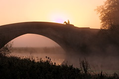 Ride at Sunrise (Darrellh2000) Tags: morning bridge light horse mist reflection sunrise river rider watersun horseride haar tyringham abigfave flickrdiamond
