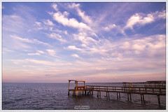 Kemah-Pier (AshishKushwaha) Tags: ocean sunset sea water canon lens relax eos evening bay harbor pier photo texas purple dusk tx houston chilling 7d ambient boardwalk waters chill soothing comforting kemah relazing rfs 1585 eos7d 1585mm
