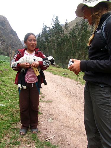 Rae talks with Julisa (and her lamb, Laurita)