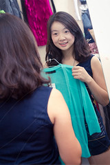 woman trying on clothing (wu.peng) Tags: portrait people beauty smiling fashion retail shirt female laughing shopping bag asian fun japanese reading mirror women sitting happiness lookingup indoors relationship shoppingmall escalators cloth try cheerful browneyes relaxation youngadult blackhair pricetag oneperson 20s paperbags lifestyles brownhair toothysmile 2530years 2025years tryingon oneyoungwomanonly tryingonclothes