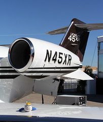 NBAA 2011 - SoaKOin' Up Some Sun - Henderson Executive Airport - Henderson, NV (tossmeanote) Tags: airplane toy airport stuffed aircraft aviation wing jet engine meeting 45 mascot business national ko convention annual henderson executive chill stichting association lear 64th 2011 nbaa piloot hoogvliegers tossmeanote n45xr