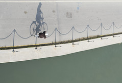 (mauspray) Tags: italy bicycle zeiss river nikon shadows general pov fiume ombre human abruzzo pescara bicicletta d300 umano portocanale riverport zf2 distagont2825 zeisscontest2011
