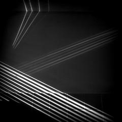 L'ombre et la lumière (TheManWhoPlantedTrees) Tags: shadow music black lines wall square shadows song diagonal tiles picnik calogero holgaish lombreetlalumière aglitchinthesystemanabstractviewofdailylife quadratum nikond3100 myphotost tmwpt todayiwokeupadayolder