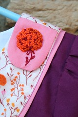 Thanksgiving Playdate Dress for Lucy Embroidered Tab Detail (Mle BB) Tags: pink orange white flower girl modern french kid berry pattern child oliver dress purple stitch handmade embroidery sewing meadow violet s knot fabric button stitching bubblegum piping sleeve handstitched pockets playdate garment yoke hem farfaraway backstitch frenchknot konacotton heatherross 34sleeve blindstitch oliverands flatpiping