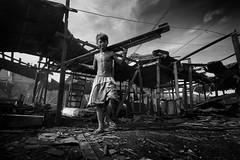 Ulingan, Tondo - Remel suffering from Hypokalemia (Mio Cade) Tags: wood boy love work kid sponsored factory muscle smoke philippines charcoal manila heavy load sick sponsor weak illness tondo remel hypokalemia ulingan