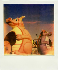 Dizzy Dragons (Nick Leonard) Tags: carnival pink blue sky film festival analog fun polaroid sx70 colorful purple nevada nick dragons scan lightleak event rides henderson landcamera polaroidsx70 polaroidlandcamera polaroidcamera instantfilm dizzydragons epson4490 firstflush colorshade integralfilm nickleonard hendersonpavilion polaroidsx70model2 theimpossibleproject px680 px680ff nevadawildfest