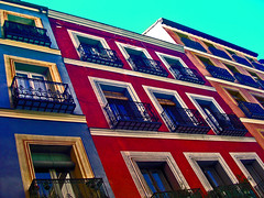 A colorful neighborhood I  <EXPLORE> (Stavros iLIADIS) Tags: barcelona street city travel blue sky house color colour art buildings spain europe view artistic olympus explore getty 2009 mygearandme mygearandmepremium epl2