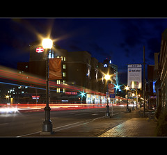 Zooming Down Main Street (Serge Babineau) Tags: street new light bus lamp night lights long exposure downtown streak zoom main brunswick nb newbrunswick moncton lamps dieppe streaks keg incolor