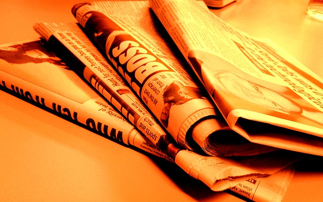 Newspaper fire orange