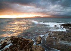 Penmon Point, Anglesey, Wales (Russell@definedlight) Tags: sea lighthouse colour wales clouds sunrise canon landscape rocks waves anglesey penmanpoint