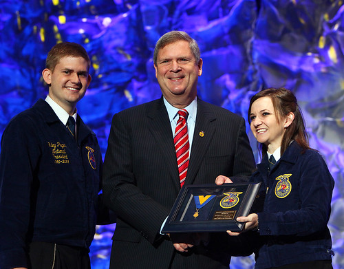 National FFA President Riley Pagett (left) and National FFA Vice President Shannon Norris (right)  present Secretary Vilsack with the Honorary American FFA Degree. This is the highest honor that the National FFA can bestow to supporters of Agricultural Education and FFA.  Photo courtesy FFA.