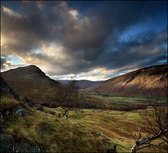 Creag nan Eildeag (angus clyne) Tags: road uk travel autumn light sunset red sky cliff cloud sun mountain black colour tree green art grass rain stone set pho
