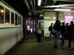 Please Remember Those Who Don't Return (J Mark Dodds [a shadow of my future self]) Tags: poster leaving for frozen looking time cone crowd watching over trainstation frombehind advert backlit staring commuters queueing standingstill newcrossgate dscf7122 transportbridge standingportrait trainpublic jmarkdodds pleaserememberthosewhodontreturn leavingthetrainstation exitbicycle railwayplatformnight