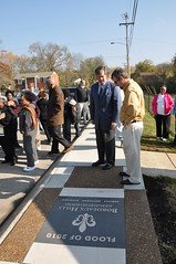 Mayor Dean and residents at the newly installed flood memorial marker
