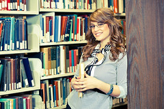 Gorgeous library girl (nathansmithphoto) Tags: woman girl face vintage hair glasses crossprocessed pretty skin library books bookshelf blouse crossprocessing librarian 1970s eyeglasses effect shelves