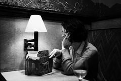 girl in seafood restaurant booth (gorbot.) Tags: blackandwhite bw restaurant glasgow roberta f19 rogano leicam8 digitalrangefinder ltmmount voigtlander28mmultronf19 siverefex