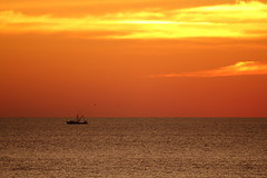 Ocean City Sunrise with Boat (Mr.TinDC) Tags: sky orange water beautiful silhouette clouds sunrise boat md horizon maryland atlantic oceancity oc fishingboat atlanticocean orangey ocmd