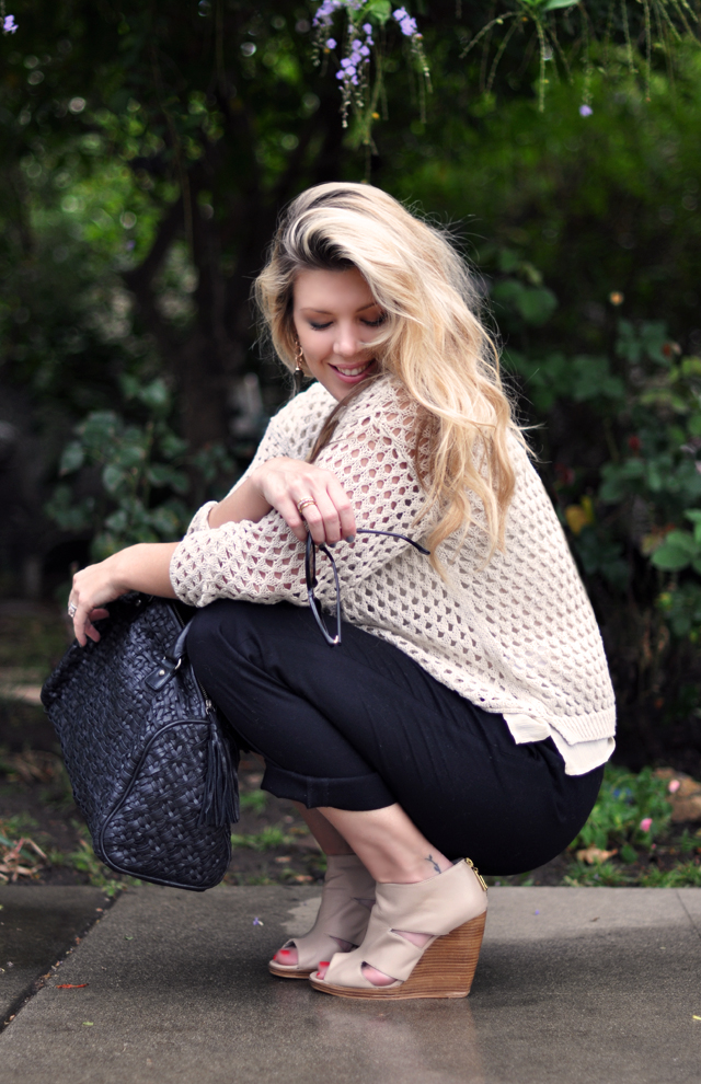 Black cuffed pants  with ivory open  knit sweater and ankle wedges
