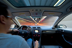 autoportrait (ISP Bruno Laplante) Tags: auto light portrait black car sunglasses vw speed self golf tdi wagon long exposure autoportrait interior lane dashboard tunel 6speed nikond700 nikkor1424mmf28 lightroom35