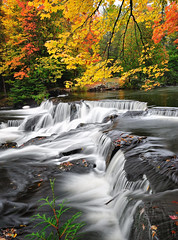 """Autumns Art""  Bond Falls - Paulding , Michigan (Michigan Nut) Tags: longexposure autumn light sky orange usa tree art fall nature water colors leaves yellow rock america forest reflections river geotagged photography waterfall leaf midwest stream michigan floating waterfalls cascade bondfalls johnmccormick nikon1635mmf4gedafsvrwideanglezoomlens"