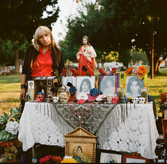 Daughter at Her Mother's Grave (susan catherine) Tags: dayofthedead losangeles hollywoodforevercemetery diasdelosmuertos yashica mat124g