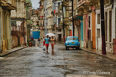 Havana Street (bjparkinson) Tags: street urban rain umbrella couple havana cuba