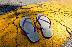 Italy (Bremme) Tags: italy white yellow purple pavement flipflops cracked