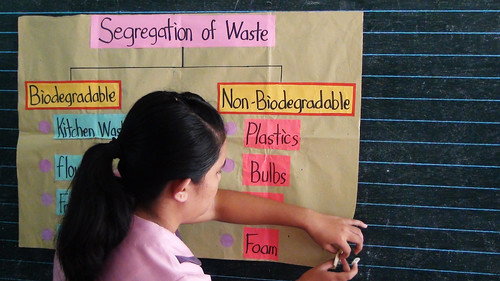 A teacher presents to a class a visual aid highlighting examples of biodegradable and non-biodegradable. (Tashuana Alemania)