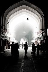 The bazaar in the morning (Silvr) Tags: light shadow people sun india bird ray arch market delhi silhouettes unesco bazaar redfort