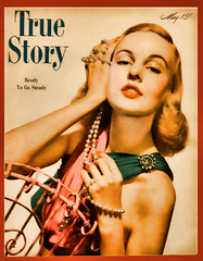 A kiss is a lovely trick designed by nature to stop speech when words become superfluous. ~ Ingrid Bergman (Clever Poet) Tags: woman beautiful true vintage magazine store colorado antique boulder pearls story secondhand