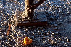 Orange on the Gravel - Long Island City, Queens (ChrisGoldNY) Tags: nyc newyorkcity stilllife orange usa newyork fruits metal closeup america construction rocks forsale album cement queens posters lic covers gothamist oranges crusty longislandcity curbed gravel bookcovers qns chrisgoldny chrisgoldberg chrisgold chrisgoldphoto chrisgoldphotos
