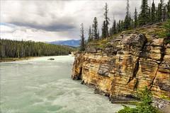 . athabasca river . (susanonline (busy these days)) Tags: canada green jasper cloudy rockface alberta jaspernationalpark palegreen rockflour athabaskariver milkygreen susanonline
