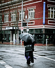Umbrella Crossing (Orbmiser) Tags: black rain oregon umbrella portland spring nikon crossing sidewalk d90 tamron1750f28 pedistrian