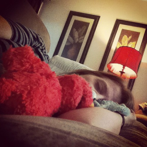 On the couch with headache and back pain. Coop brought me his blankie and Elmo. by kimberly.kalil