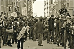 recession procession ..... (ana_lee_smith) Tags: people bw toronto canada sepia portraits vintage lens photography march downtown cityhall candid protest photojournalism saturday demonstration beercan 99 signage government capitalism kingstreet stockexchange demonstrators citizens baystreet socialdocumentary corruption participants nathanphillipssquare corporations generalassembly occupants photosof streetphotograohy analeesmith stjamescathedralpark globalmovement sonyslta33 occupywallstreet minoltaaf50210mm occupytoronto occupyingtoronto kingadelaidejarvischurch october22nd2011 kingyongeintersection crossingyongest