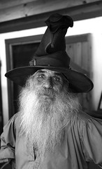 Quizzical Wizard (wyojones) Tags: blackandwhite bw usa white man black hat festival beard eyes texas wizard trf moustache wise faire renfaire grayscale renaissancefestival fest wrinkles renaissance renaissancefaire renfest greyscale rennie wizardhat graybeard handsonhips texasrenaissancefestival toddmission wyojones