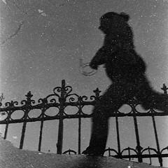 Place d'Italie (flallier) Tags: paris placeditalie xiiie 13e nikon hp5 d76 argentique film 35mm reflect nikonfm parissouslapluie reflet grain filmgrain pluie flaque flaquedeau water grille paris13 puddle noiretblanc blackandwhite nb bw bnw mono monochrome analog