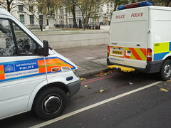 Police vans parked on double red lines in a cycle lane. (Jamie Kitson) Tags: london cyclists police bikes cyclelane cyclelanes doubleredlines doublered flickrandroidapp:filter=none doublereds cyclelaneobstructions