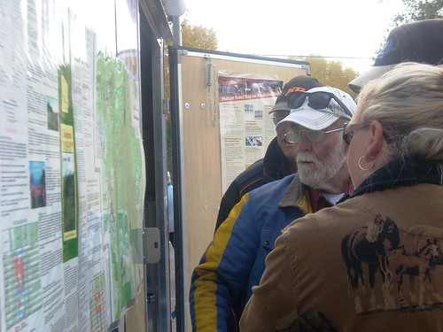 Ned Greeneltch, an Arizona Off-Highway Vehicle Ambassador Program, explains the Coconino National Forest visitor map. A National Trails Day event included discussion about plans to develop a motorized and non-motorized trail system on the forest.