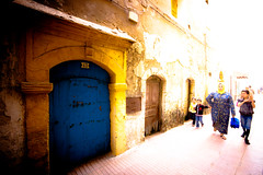 Essaouira Medina (Umbreen Hafeez) Tags: africa door blue people color colour yellow lady walking children women child african hijab morocco maroc essaouira moroccans