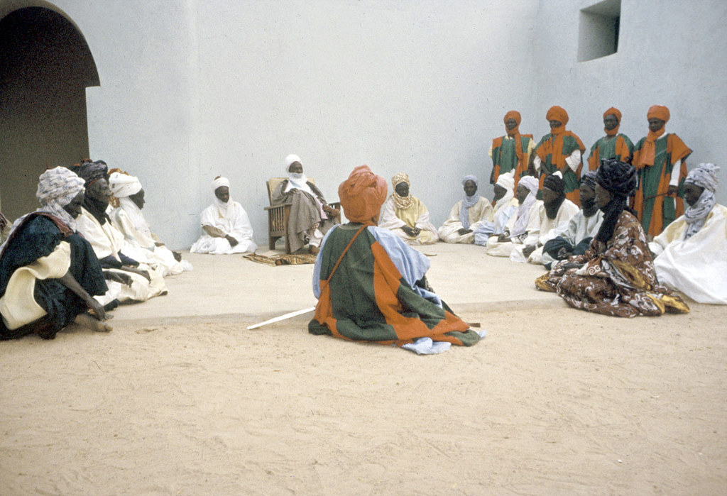 The Emir of Katsina, Sir Alhaji Usman Nagogo, holding a morning greeting ceremony, Katsina, Nigeria. [slide] 1959. eepa_01375