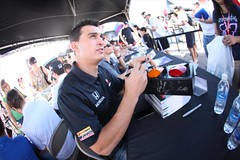 Graham Rahal signs some autographs for fans at the fan village autograph session (IndyCar Series) Tags: camera speed canon eos mark 5d length mode rating 151 5focal 2810iso 500metering iiexposure 1400fnumber
