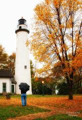 Pointe Aux Barques Lighthouse (Happy Photographer) Tags: fall colors rain umbrella nikon lighthouses michigan d300 pointeauxbarqueslighthouse topphotospots tpslandscape